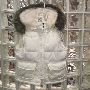 Quilted puffer vest with faux fur trimmed hood